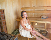 Young pretty woman in sauna — Stock Photo