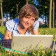 Young woman with laptop outdoors — Stock Photo #37803199