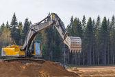 Sarı inşaat tarak iş başında — Stok fotoğraf