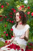 Romantic woman in rose petals — Stock Photo