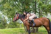 Elegant attractive oman riding a horse — Foto de Stock