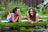 Two beautiful young brunet woman outdoors — Stock Photo