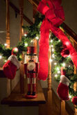 Nutcracker by Christmas garland — Stock Photo
