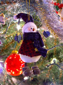 Snowman ornament on tree — Stock Photo