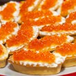 Red caviar in tartlets — Stock Photo