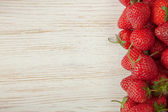 Strawberry on a wooden background — Stock Photo