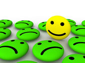 Happy smiley face among sad smileys — Stock Photo