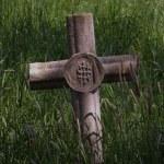Cross in llong grass — Stock Photo