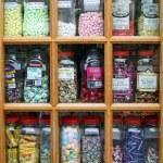 Sweet Jars in Shop Window — Stock Photo
