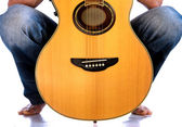 Go Folk - Guitar between his legs — Stock Photo