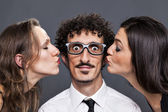 Double kiss from his girlfriends — Stock Photo