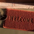 Welcome doormat - Stock Photo