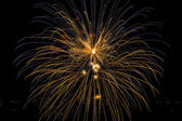 Blue and yellow firework — Stock Photo