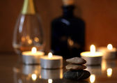 Stones for Spa of procedures against burning candles — Stock Photo