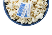 Blue bowl with popcorn and cinema tickets — Stockfoto