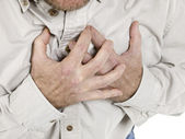 Old man holding his chest — Stock Photo