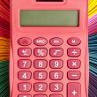 Close up shot of a calculator and color palette — Stock Photo #13386751