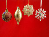 Christmas bauble against red background — Stock Photo