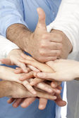 Diverse group of peoples hands together — Stock Photo