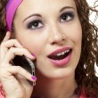 Girl in neon on mobile phone — Stock Photo