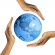 Human hands and earth — Stock Photo