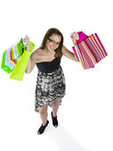 High angle view of a teenage girl holding up shopping bags — Stock Photo