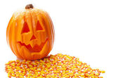 Jack o lantern and candy corn — Stock Photo