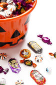 Overflowing halloween bucket — Stock Photo
