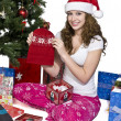 Smiling young woman showing her christmas gift — Stock Photo #13424967