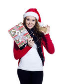 Happy female with her christmas present and a placard — Stockfoto
