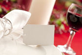 White plate and a blurred wine glass — Stock Photo