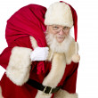 Santa claus with gift bag — Stock Photo