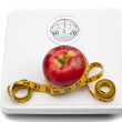 Stock Photo: Apple and scale