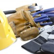 Close up shot of yellow hard hat work gloves and tool belt — Stock Photo #13438863