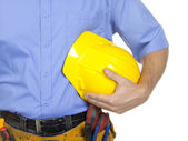 Worker carrying a hard hat — Stock Photo