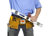 Construction worker with a level ruler — Foto Stock