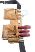 Tool belt with screwdriver and spanner — Stock Photo