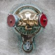 Fire hydrant on a building — Stock Photo #14083249