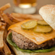 Stock Photo: Garnishing hamburger sandwich