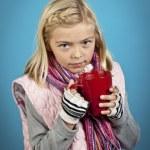 Girl drinking hot coco — Stock Photo