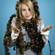 Stock Photo: Girl gesturing with christmas lights and decorations