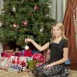 Girl sitting in front of tree - Stockfoto
