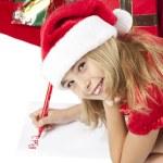 Girl writing letter to santa — Stock Photo