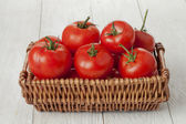 Basket of fresh tomatoes — Stock Photo