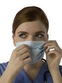 Female nurse with mask — Stock Photo