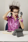Female office staff yelling on the phone — Stock Photo