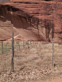 Fence with cliff in background — Stock Photo