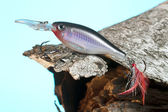 Fishing lure and wood — Stock Photo
