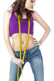 Front view of a female with measuring tape — Stock Photo