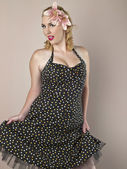 Gorgeous woman with polka dots dress — Stock Photo